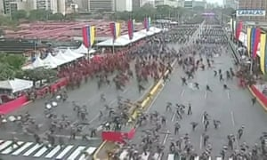 Hundreds of Venezuelan soldiers break formation after an evacuation warning following the detonation of 'drone-type flying devices'.