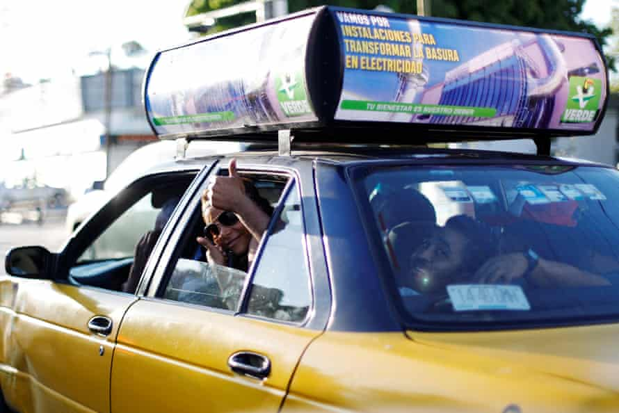 A ride in a taxi before embarking on a new leg of their travels, in Tlaquepaque, Jalisco state, 18 April