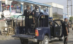 Police officers patrol near the Lekki toll gate in Lagos, Nigeria