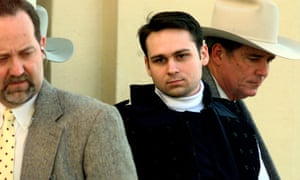 John William King, center, is escorted from the Jasper county Courthouse after being found guilty of capital murder on 23 February 1999.