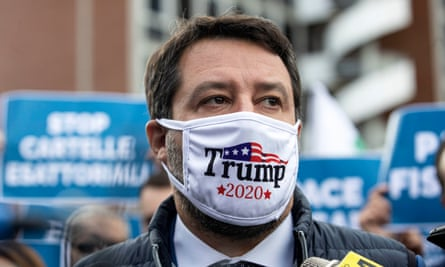 Italy's Matteo Salvini wearing a 'Trump 2020' face mask at a protest in Rome this month