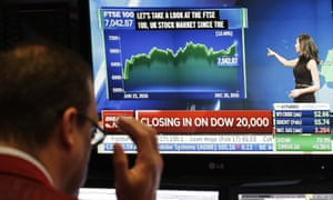 A stock trader follows information on the Dow Jones index