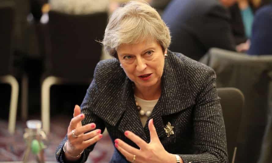 Theresa May is pictured speaking at Queen's University in Belfast on 27 November 2018.
