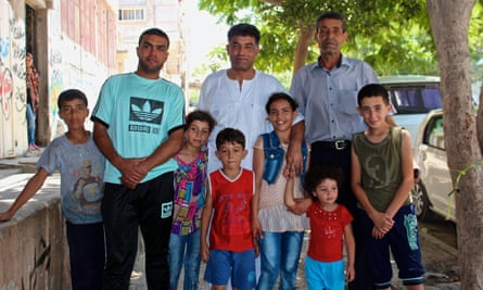 Thair Salah Mortaja (left) next to his uncle (centre) and father (right), and his uncle's children.