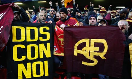 Roma fans hold banners in honour of Daniele De Santis, who murdered a rival fan in 2014.