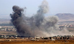 Smoke rises after Russian airstrikes on the Syrian side of the Golan Heights