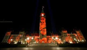 """Ottawa, Canada Poppies are projected on Centre Block as part of the Royal Canadian Legion's """"virtual poppy drop"""" on Parliament Hill"""