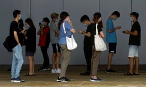 People queue up for Covid tests in Singapore.