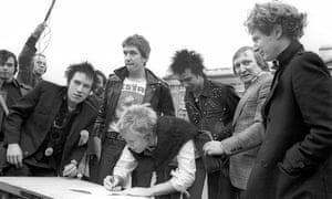 Cash from chaos: the Sex Pistols sign a record deal with A&M outside Buckingham Palace, March 1977