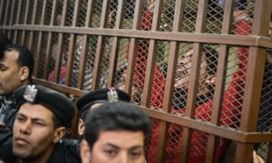 """2015: Defendants react behind the bars at a court in Cairo following the acquittal on January 12, 2015 of 26 male men accused of """"debauchery"""" after they were arrested in a night-time raid on a bathhouse in the Egyptian capital last month that triggered international concern."""