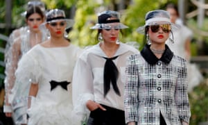See-through plastic hats were in abundance at Chanel's spring-summer collection in Paris.