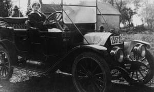 A woman at the wheel, circa 1913.