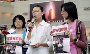 Lee Ching-yu, center, wife of Taiwanese pro-democracy activist Lee Ming-che detained in China, gives a press conference about his fate.