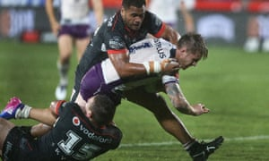 Jacob Lillyman and Sam Lisone tackle Cameron Munster during the clash between the New Zealand Warriors and the Melbourne Storm at Mount Smart Stadium in Auckland.