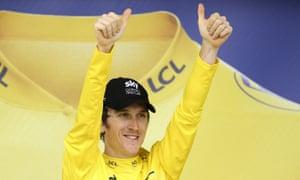 Geraint Thomas celebrates in yellow.