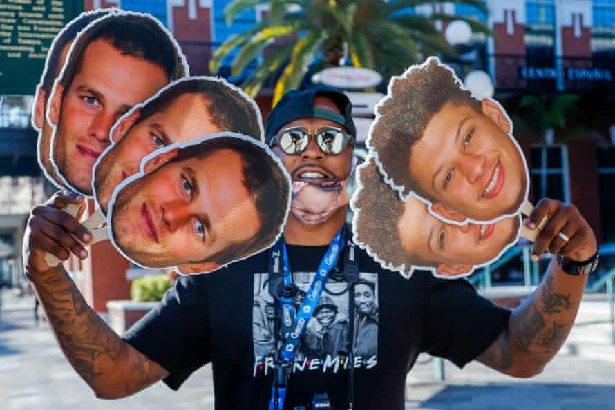 A vendor sells Tom Brady (left) and Patrick Mahomes fans in the historic Ybor City neighbourhood in Tampa, Florida.