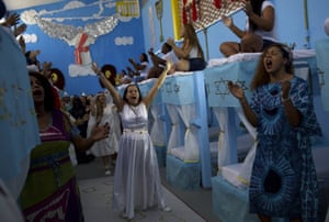 Women sing and dance during a performance
