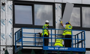 Cladding is removed from a tower block in Greater Manchester
