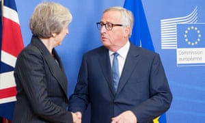 Theresa May with Jean-Claude Juncker in Brussels.