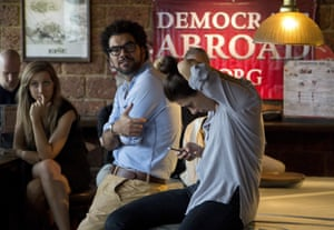 Guests at a Democrats Abroad event react as they watch the US election