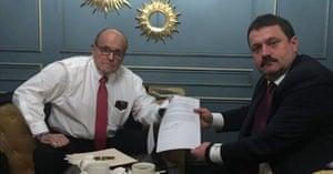 Ukrainian lawmaker Andriy Derkach meets with Donald Trump's personal lawyer, Rudy Giuliani in Kiev.