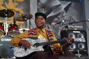 David 'Honeyboy'  Edwards with guitar