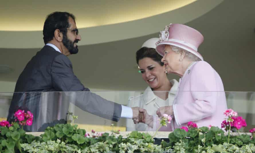 Queen Elizabeth greets the ruler of Dubai, Sheikh Mohammed, and his wife Princess Haya in the royal box at Royal Ascot horse race meeting in 2016.