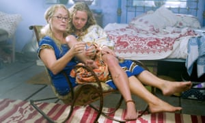 Meryl Streep wearing glasses, with young girl Amanda Seyfried on her lap in Mamma Mia!