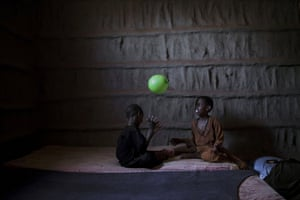 Six-year-old Maydiigo plays with seven-year-old Abaay at the village of Owdiinl.
