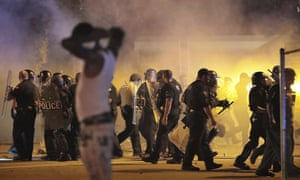 Police retreat under a cloud of tear gas as protesters disperse from the scene of a standoff Wednesday in Memphis, Tennessee.