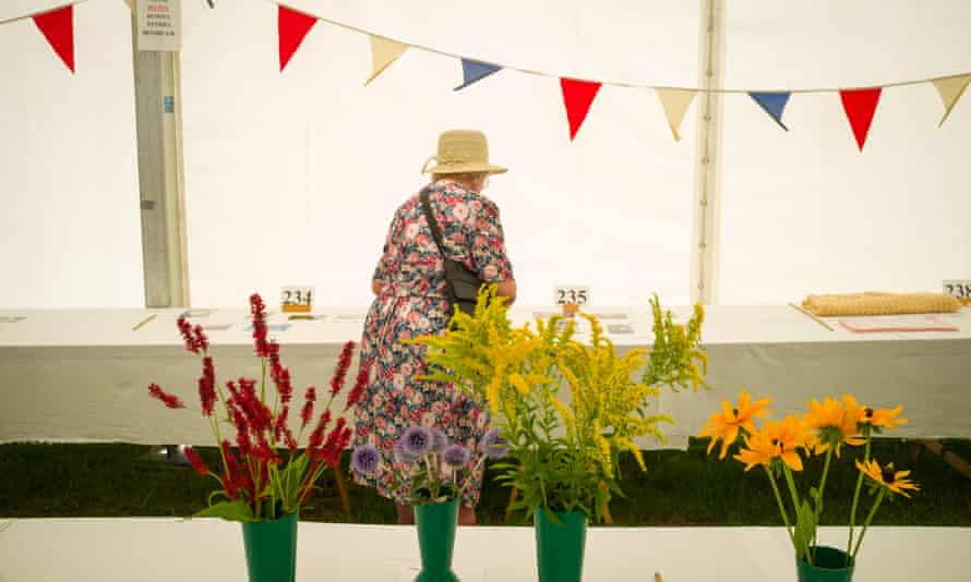 A lady in a flowery Summer dress at a flower show