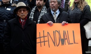 Activists at a rally in New York against Donald Trump's border wall