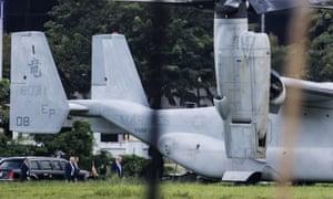 US President Donald Trump prepares to board Marine One in Manila.