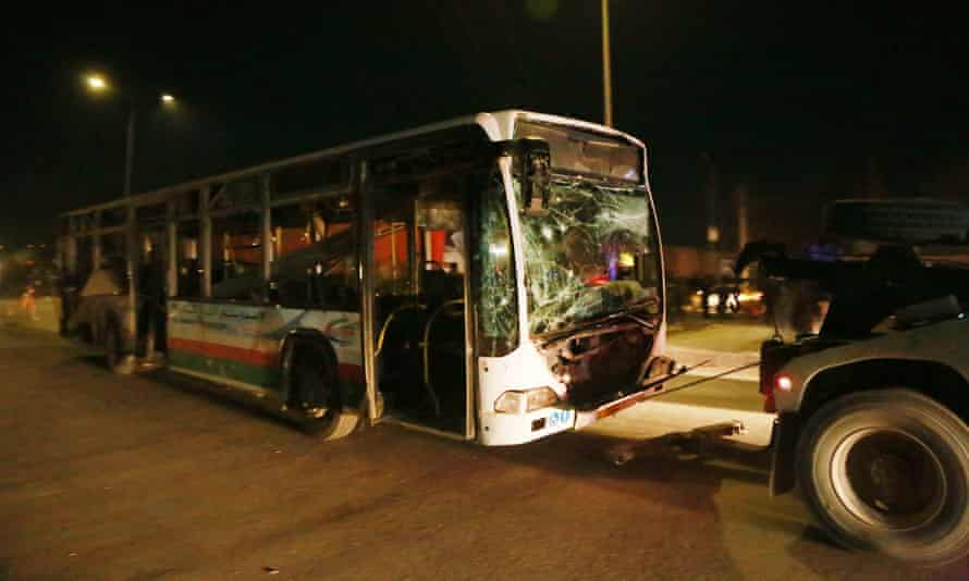 A bus damaged by a bomb is towed away
