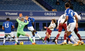 Pickford flaps at a shot from Luiz which hits the post.