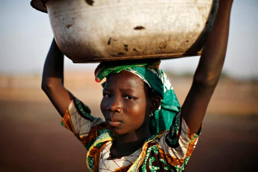 A Ghanaian girl waits to sell water in the northern city of Tamale, Ghana