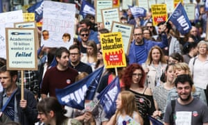 Striking teachers carry banners at a demonstration in Leeds