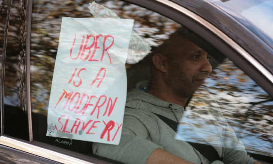 An Uber driver takes part in the protest.