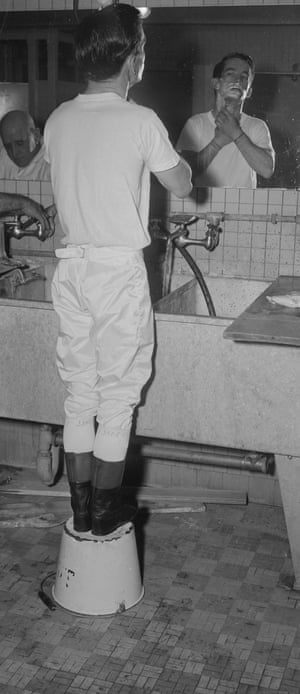 Willie Shoemaker shaves in the dressing room at Jamaica Track in October 1951.