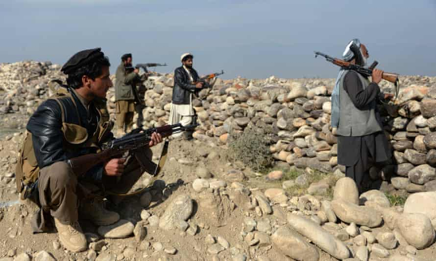 Afghan militias pictured in 2015. Critics worry the plans will amplify existing rivalries and be difficult to regulate.