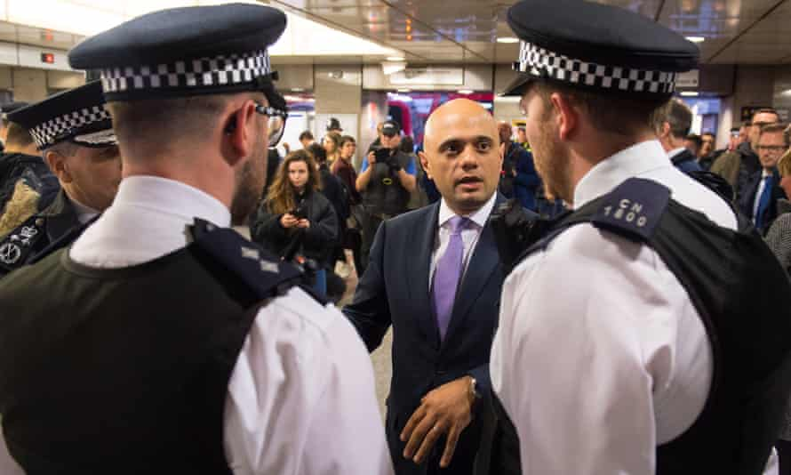 Sajid Javid with police officers during a visit to Angel tube station in March to announce plans to increase stop and search powers.