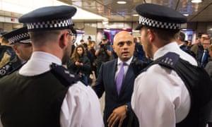 Sajid Javid with police officers