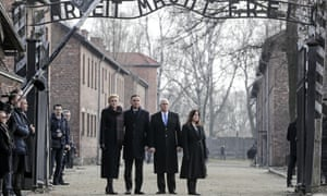 Poland's president, Andrzej Duda, and his wife, Agata Kornhauser-Duda (left), accompany the US vice-president, Mike Pence, and his wife, Karen Pence, on a visit to Auschwitz-Birkenau in Poland