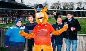 Joel Golby as football mascot Bertie the Beaver with fans at Hampton & Richmond Borough FC