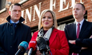 Sinn Fein Vice President Michelle O'Neill with party colleagues John Finucane (left) and Chris Hazzard (right).