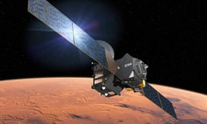 An artist's impression showing the European Space Agency's ExoMars Trace Gas Orbiter in orbit around Mars.