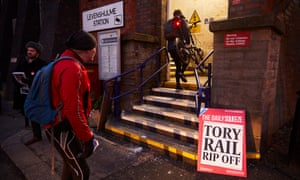 Protesters against rail fare rises at Levenshulme station in Manchester.