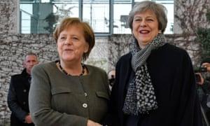 Angela Merkel (left) with Theresa May