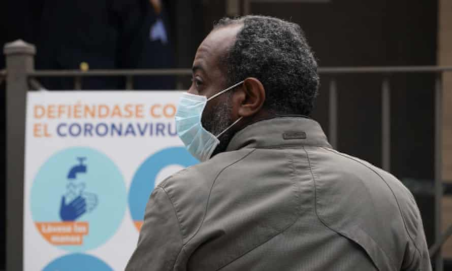A man waits for a Covid-19 test in the Harlem neighborhood of New York, New York, on 20 April.