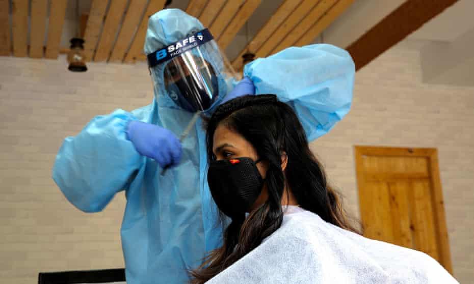 Hair stylist Ravi HC wearing PPE